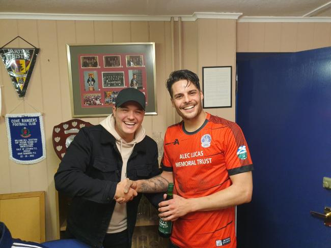 Man of the match Paul Thomson presented with a bottle by former Vale player Andy Martin.The club donned their new kit for the game, which is sponsored by the Alex Lucas Memorial Trust. Photo: Vale of Leithen