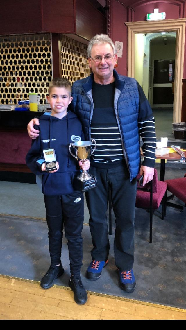 Aaron collects his trophy from coach John Motion