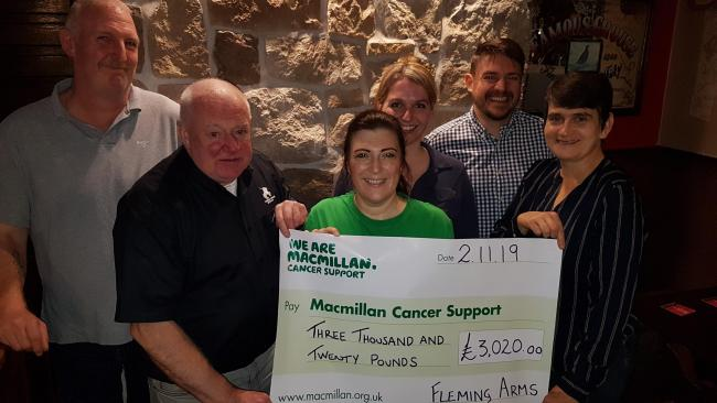 The group from the Fleming Arms presented a cheque to Macmillan's Angela McCormack