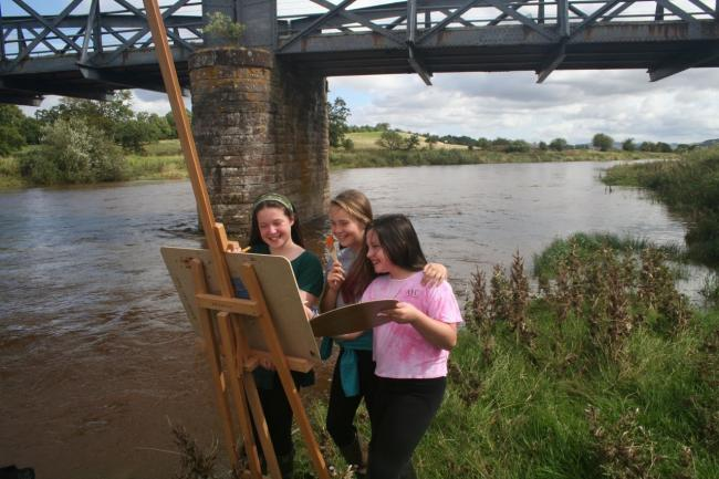 Kate Fergusson, Olivia Prentice and Emma Fergusson create a masterpiece on the banks of the Teviot