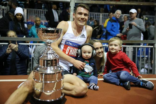 Chris celebrates with his family after regaining the Millrose Mile title. Photo: John Nepolitan
