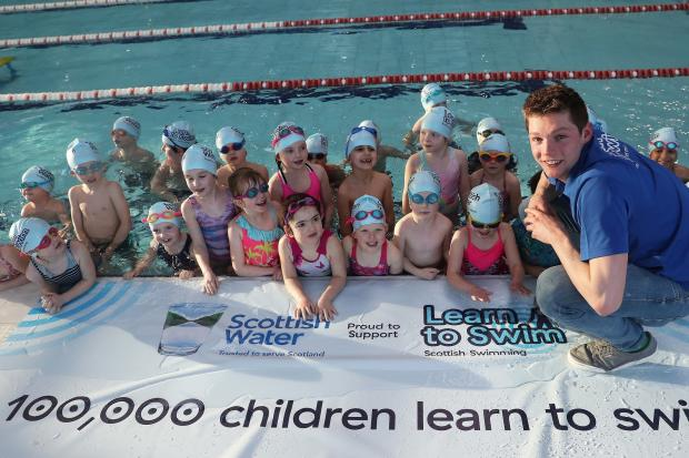 Olympic medalist, Duncan Scott, with some of the project's swimmers. Photos: lan MacNicol