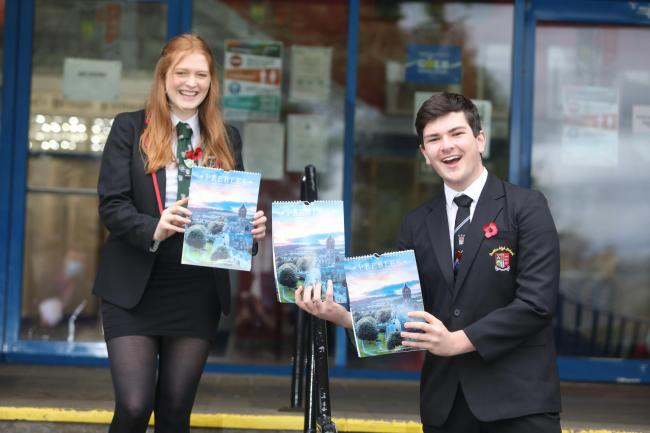Peebles High School head girl and boy Abbie Sorrell and Euan Macrae with the calendar