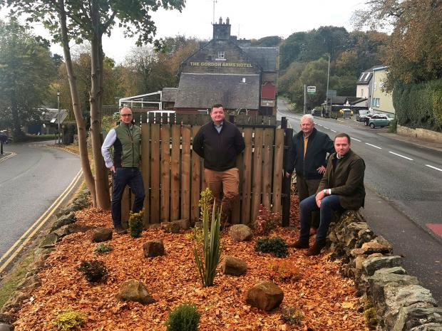 Peeblesshire News: Volunteers at the football club helped with the tidy up