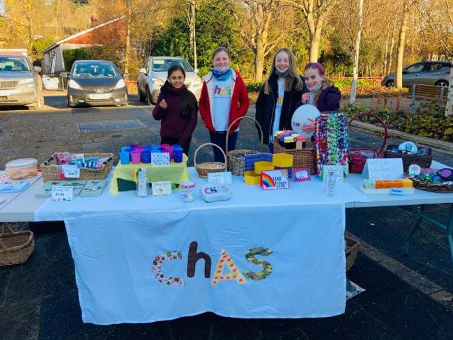 L-R: Ayushi Kumar,  Lucy Hall, Zennor Motley and Ivy Russell at their stand at West Linton Market for CHAS