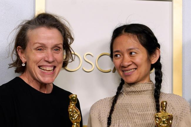 Frances McDormand and Chloe Zhao with their Oscars for best picture winner Nomadland (Chris Pizzello/AP)