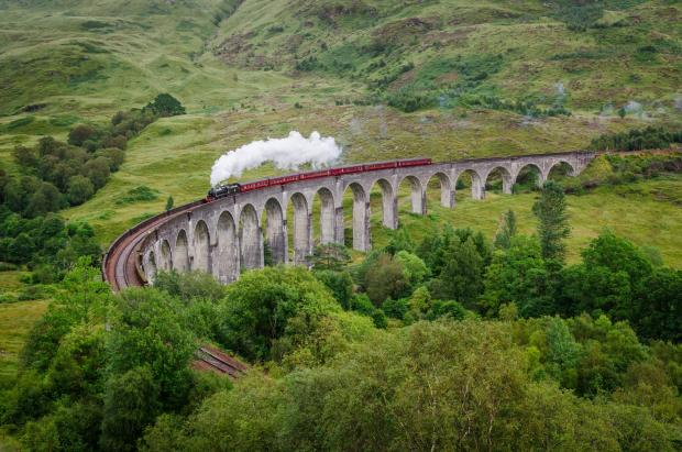 Peeblesshire News: View of a steam train on a famous Glenfinnan viaduct, Scotland; Shutterstock ID 154641122; PO: THE HERALD MAGAZINE ; Job: TRAVEL