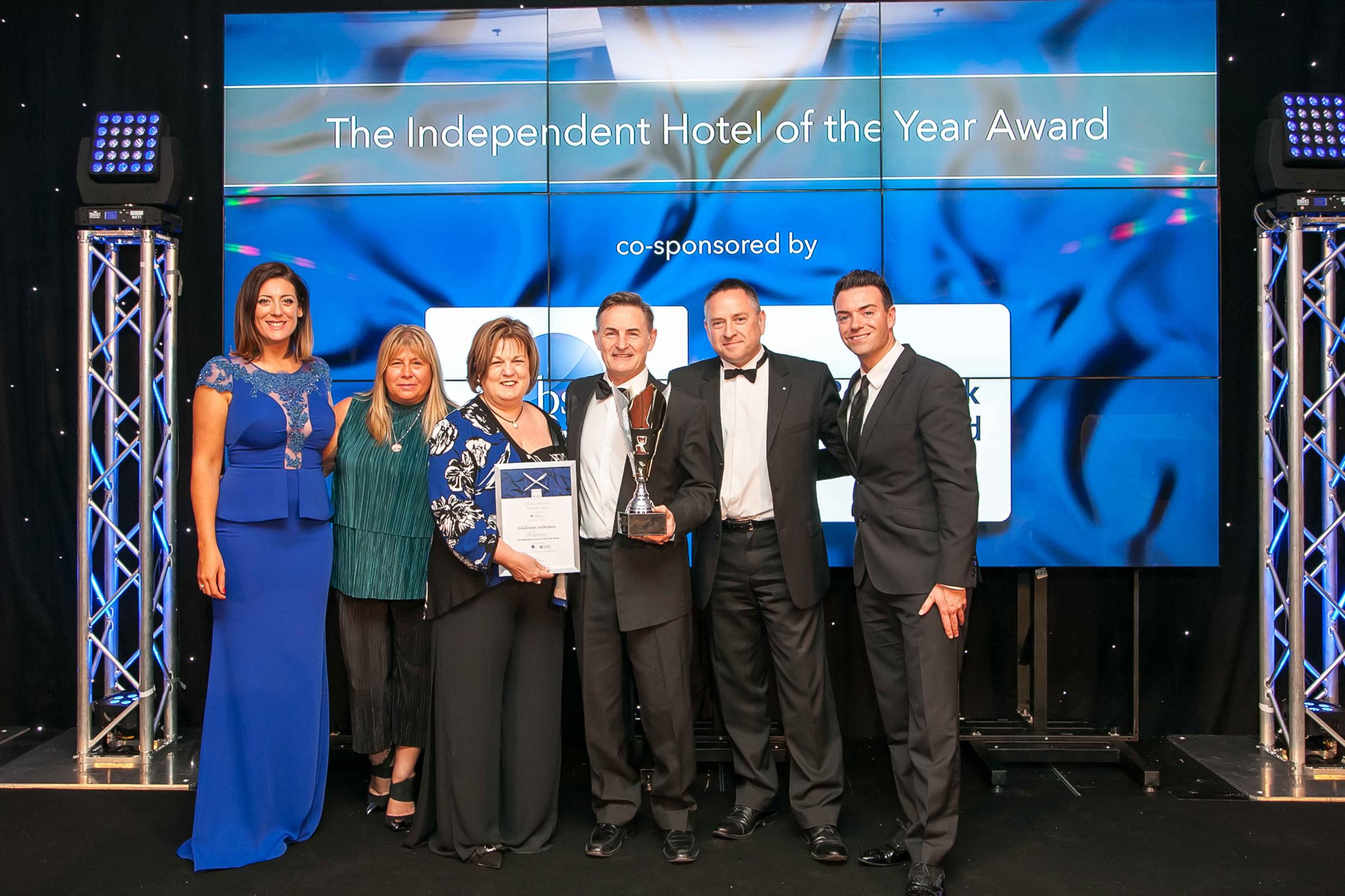 John and Sylvia Matthews (centre) with event presenters Catriona Shearer and Des Clarke (far left and right), and category sponsors Carol Ward of Bruce Stevenson insurance brokers and Stephen MacGregor of the Royal Bank of Scotland