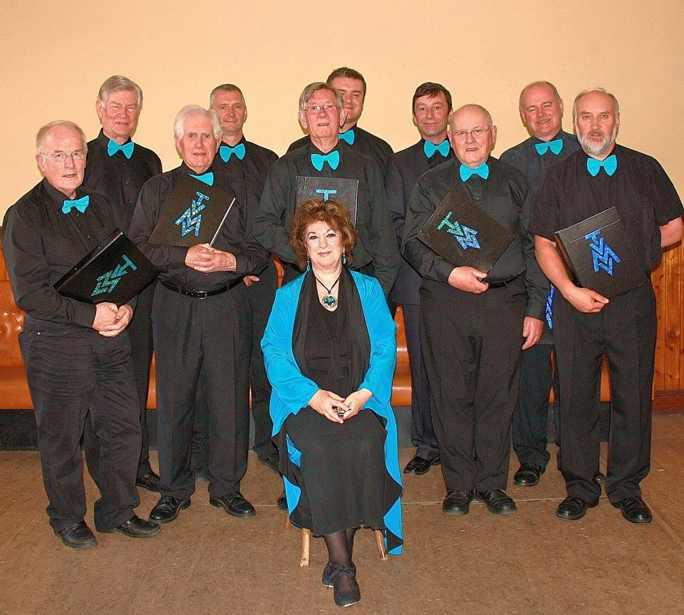 Director Helen Furness with Tweed Valley Male Voices.