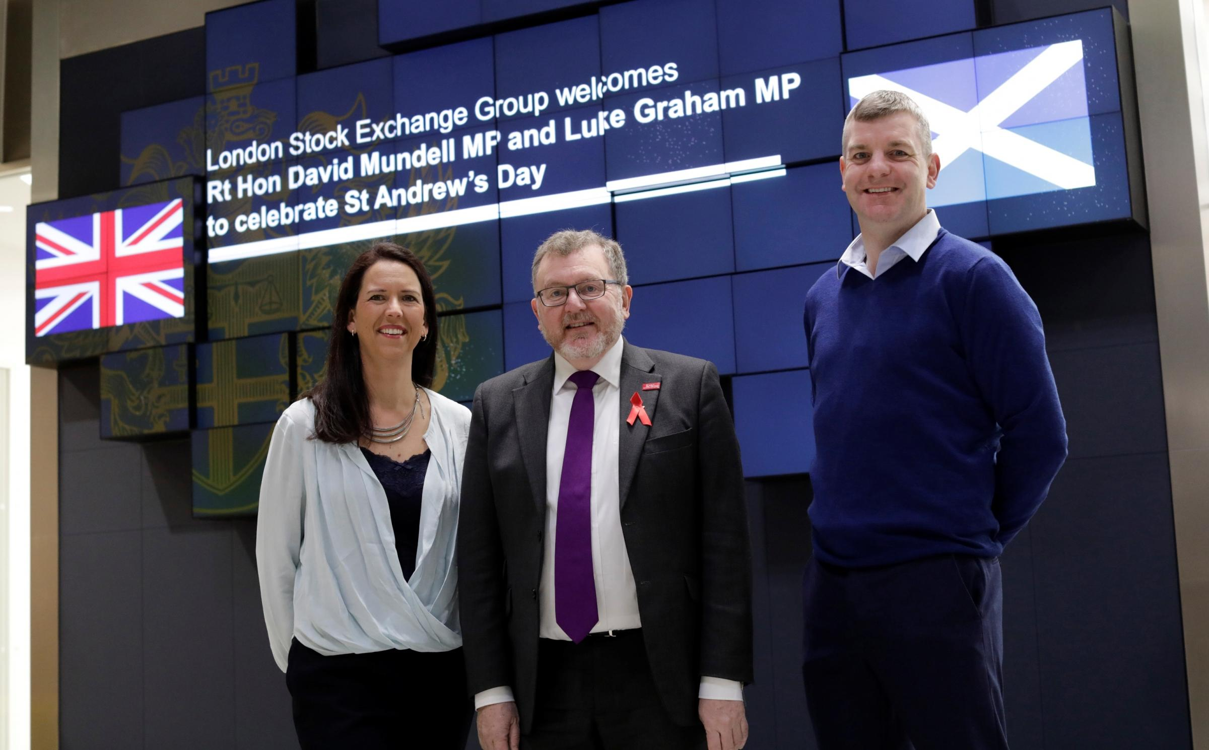 Mr Mundell with Ruth and David Hinks at the Stock Exchange