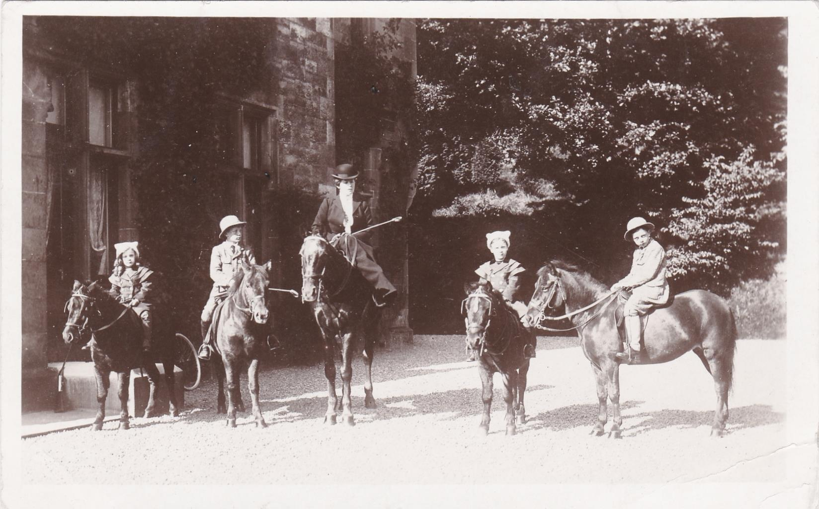 Family of riders outside Caerlee House c1910