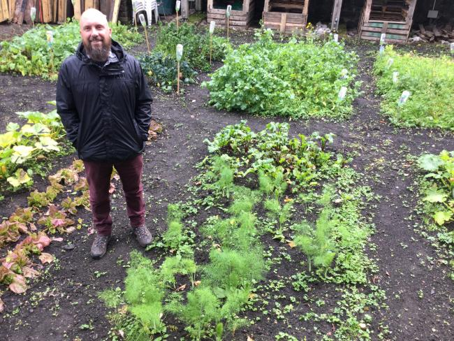 Adam Skelton in the Courthouse Community Garden in Peebles