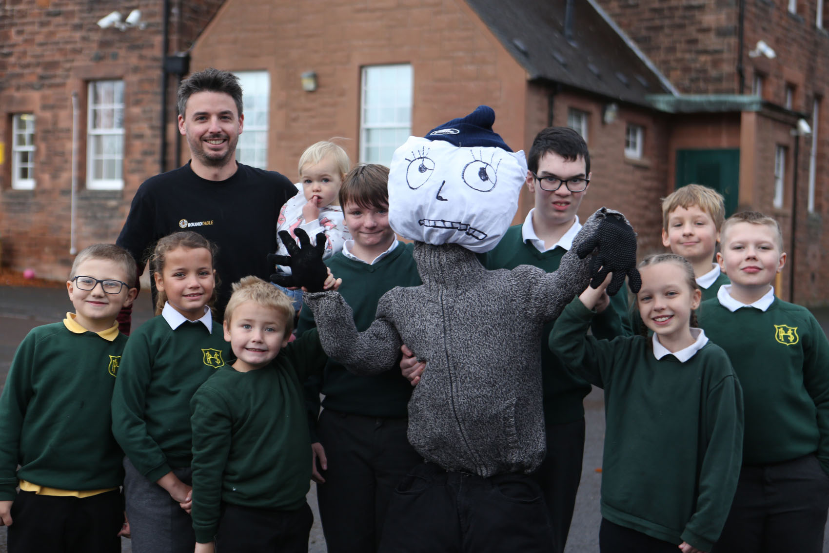 Halyrude Primary School pupils with the Guy they have made for the bonfire, with Matt Kennedy from the Round Table with his daughter Maeve aged two. Photo: Helen Barrington