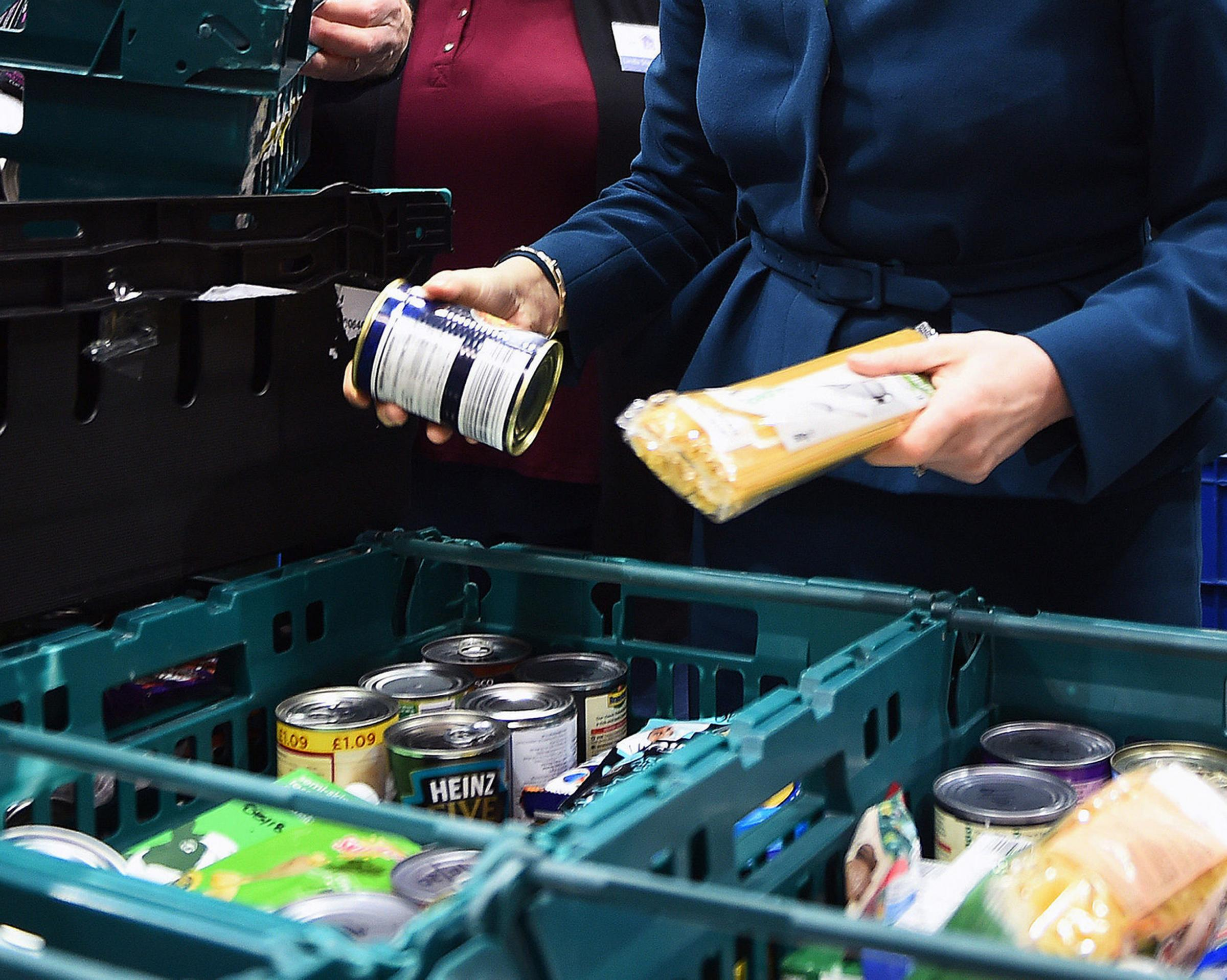 Embargoed to 0001 Tuesday November 06  File photo dated 17/01/18 of goods   at a food bank. Figures from the Trussell Trust reveal problems with Universal Credit are driving an increase in the number of emergency supplies handed out at foo