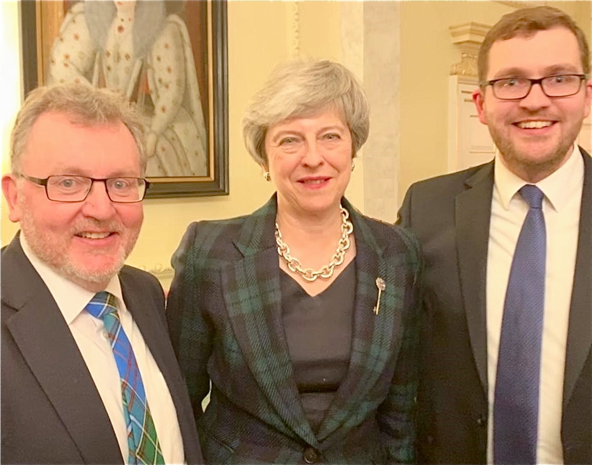 Prime Minister Theresa May with David Mundell and his son Oliver, the Dumfriesshire MSP, at the Downing Street Burns Supper