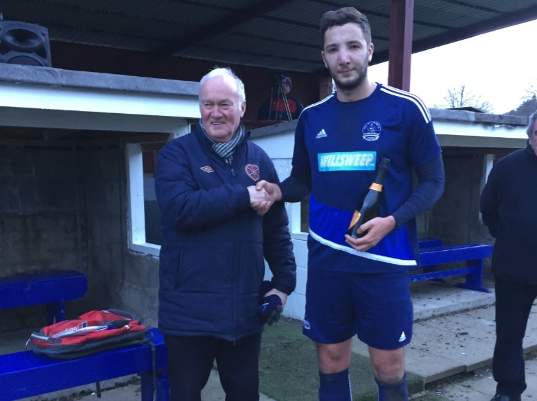Craig McBride collects the man-of-the-match award from sponsor Andrew caldwell