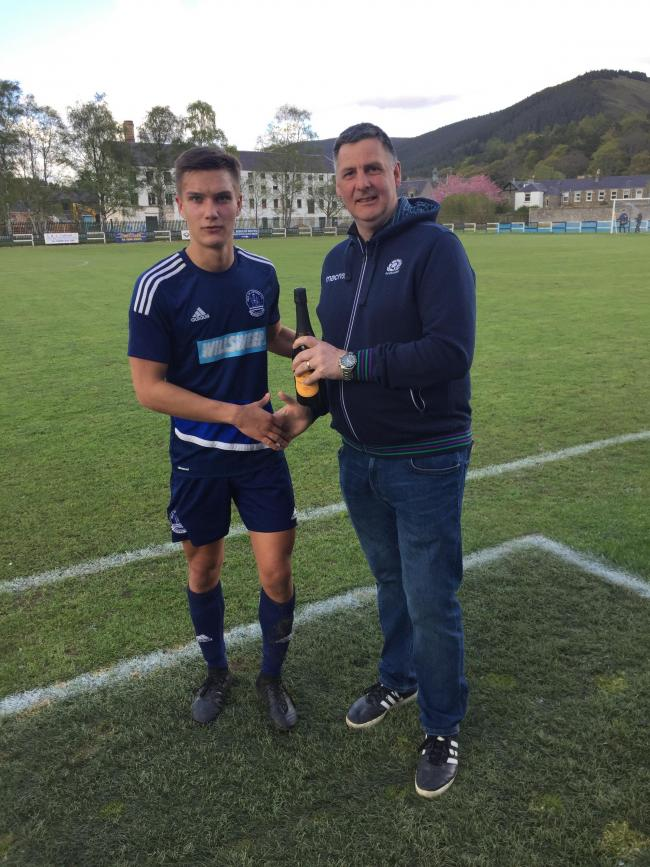 Steven Gibb presents Liall Smith with his man of the match award. Photo: David Knox