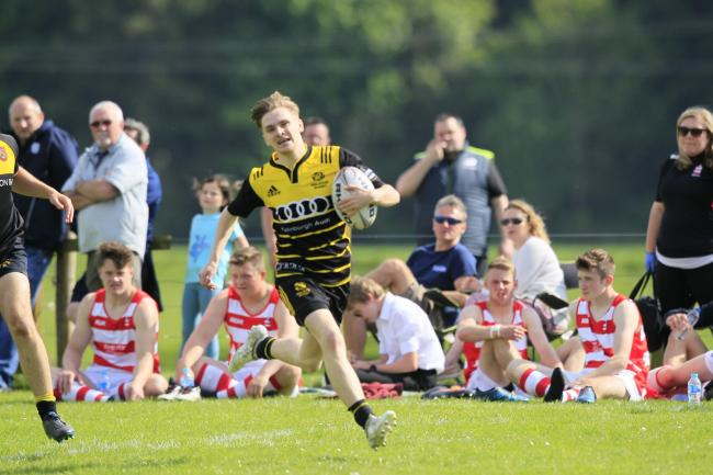 Melrose Storm on their way to winning last year's Walkerburn 7s.